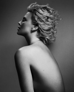 Charlize Strips down for Elle Magazine